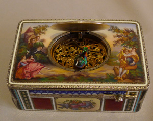 Singing bird box in silver and hand painted enamel by Griesbaum in fitted leather case.