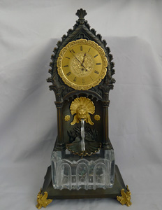 Antique French Gothic mantle clock with water automaton feature.