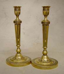 Pair of antique French Empire ormolu candlesticks.