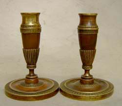 Pair of antique English patinated bronze and ormolu candlesticks.