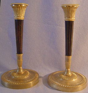 Antique pair of French Directoire patinated bronze & ormolu candlesticks.