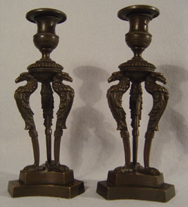 Antique pair of English George IV patinated bronze triform eagle candlesticks.