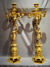 Pair antique French ormolu candelabra held by oriental figures.