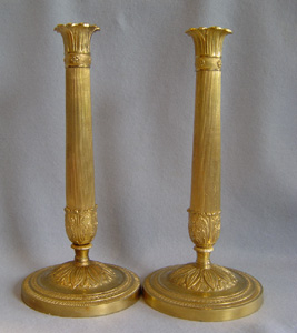Antique French pair of ormolu candlesticks.