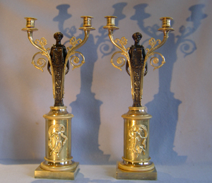 Pair French Empire ormolu and patinated bronze two branch candelabra.