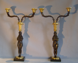 Unusual pair of Empire two branch candelabra in gout d'Egypt or Egyptian style
