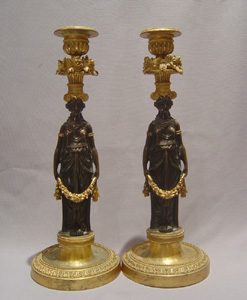 Antique candlesticks French Empire in ormolu and patinated bronze.