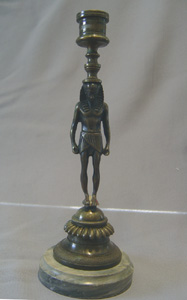 English Regency bronze candlestick in the goute d'Egypt.