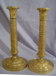 Antique candlesticks French Empire in ormolu .