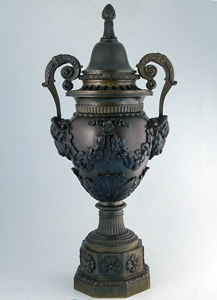 Large antique bronze lidded urn.
