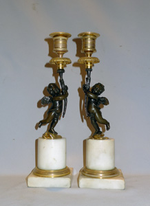 Pair English Regency figural candlesticks in carrera marble, ormolu and patinated bronze.