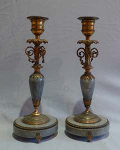 Antique French Directoire candlesticks in ormolu and Bleu Tarquin marble.