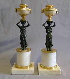 Pair of antique English Regency white marble, ormolu and patinated bronze candlesticks.