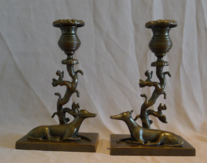 Antique late English Regency naïve true pair of animalier candlesticks of greyhounds and squirrels.