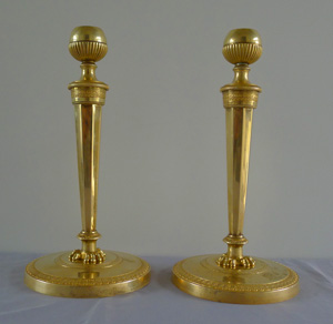 Fine antique French Empire pair of ormolu candlesticks with original hand cut threads.