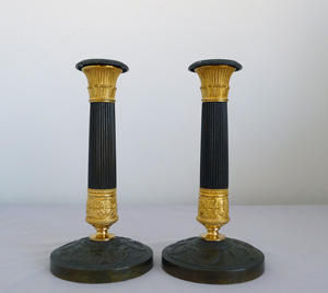 Antique pair French Charles X ormolu and patinated bronze candlesticks.