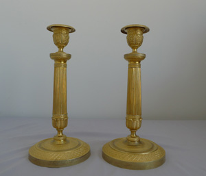 Antique pair of Charles X antique French ormolu candlesticks.