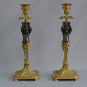 Antique French pair of ormolu and bronze figural candlesticks