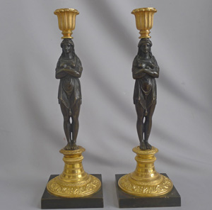 A fine pair of Omolu and Patinated bronze French Empire figural Candlesticks in manner of Thomire