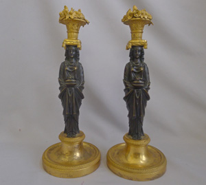 Magnificent pair of English Regency figural candlesticks in the manner of Thomas Hope.